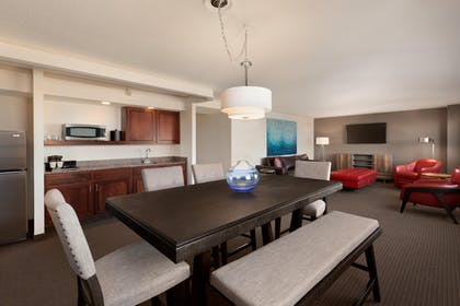 Deluxe Suite Living Area | Deluxe 2 Bedroom Suite - 1 King - 1 Queen - Sofabed | Embassy Suites by Hilton Baltimore Inner Harbor