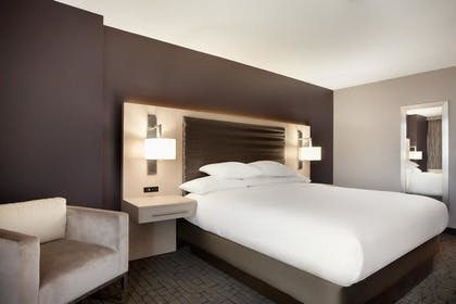 King Bed | 1 King 2 Room Suite | Embassy Suites By Hilton Charlotte Uptown