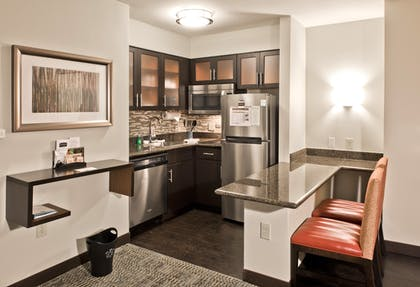 One Bedroom Suite Kitchen | 1 Bedroom Suite 1 King Bed Nonsmoking | Staybridge Suites Charlotte Ballantyne