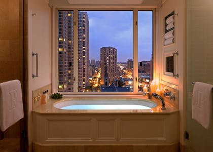 Bathroom | Executive Suite + Deluxe King | The Peninsula Chicago