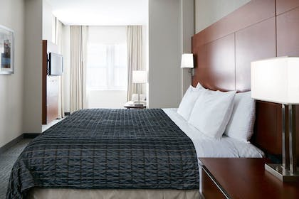Bedroom | One Room Suite With Kitchenette | The River Hotel