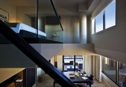 Living Area and Stairs | Penthouse Suite | Thompson Chicago