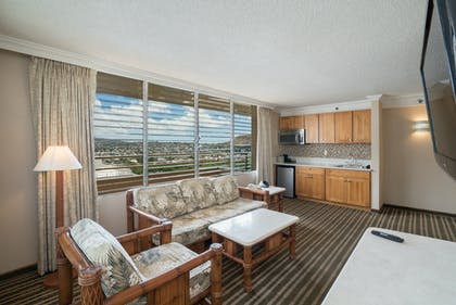 Living area seating and kitchenette  | Penthouse Suite Ocean View Lanai | Queen Kapiolani Hotel