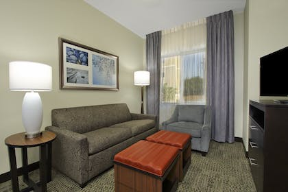 Two Bedroom Suite Couch | 2 Bedroom Suite 2 Beds | Staybridge Suites Houston W - Westchase Area