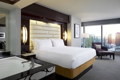 Bedroom   1 Bedroom King Suite with Sofabed   Elara by Hilton Grand Vacations
