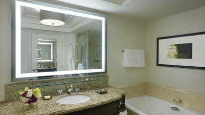 Deluxe Bathroom | One-Bedroom Suite King + Deluxe King + Deluxe Doubles | Four Seasons Hotel Las Vegas