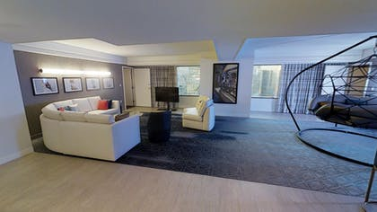 Living Room with Hanging Chair | Ultra Boulevard Suite | Planet Hollywood Resort & Casino
