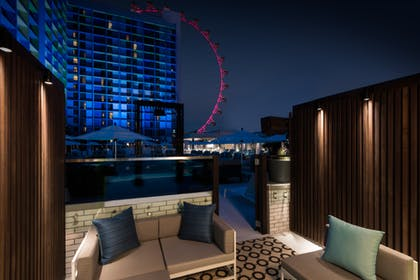 Night View | Deluxe Poolside Cabana | 2 Doubles | The LINQ Hotel & Casino