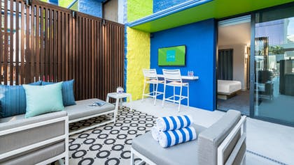 Lounge Area | Deluxe Poolside Cabana | 1 King  | The LINQ Hotel & Casino