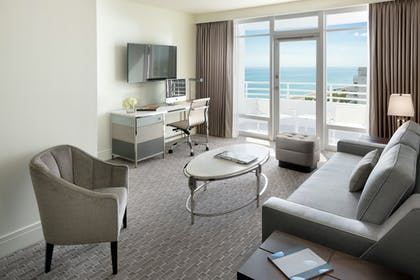 Living Room and Balcony | Bay View Junior Suite with Balcony | King | Fontainebleau Miami Beach