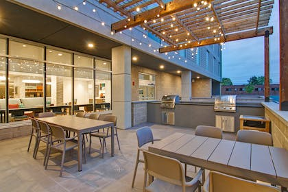 Exterior Patio BBQ | Home2 Suites by Hilton Montreal Dorval