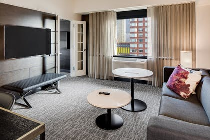 living room | 1 King Corner Junior Suite City Vw w/Sofabed | DoubleTree by Hilton Hotel & Suites Jersey City