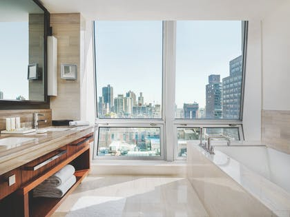 Junior suite bathroom | Junior Suite + Junior Suite | The Langham, New York, Fifth Avenue