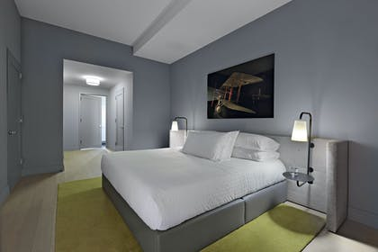 Bedroom   One Bedroom Apartment with Office   Q & A Residential Hotel