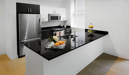 Kitchen   One Bedroom Apartment with Office   Q & A Residential Hotel