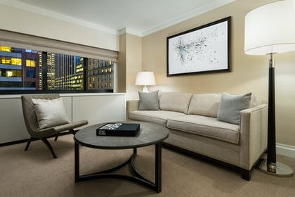Living room   One Bedroom Suite   The Manhattan at Times Square Hotel