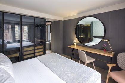 Bedroom | Deluxe King Suite | The Time New York