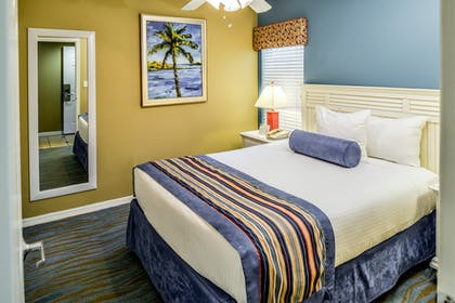 Bedroom 1 | One Bedroom Suite | Barefoot'n Resort by Diamond Resorts