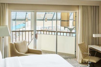 Indoor Balcony | 1 King Bed Junior Suite with Sofabed | DoubleTree by Hilton Orlando Airport