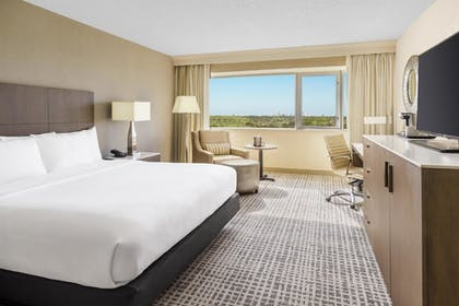 Bedroom | 1 King Bed Junior Suite with Sofabed | DoubleTree by Hilton Orlando Airport