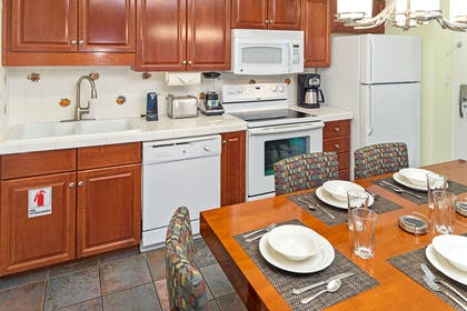 Kitchen and Dining Table | Three Bedroom Suite | Grand Beach