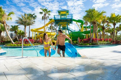 Slides with Couple | The Grove Resort & Water Park Orlando