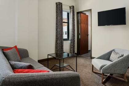 Junuior Suite Living | 1 King Bed Junior Suite | Distrikt Hotel Pittsburgh, Curio Collection by Hilton
