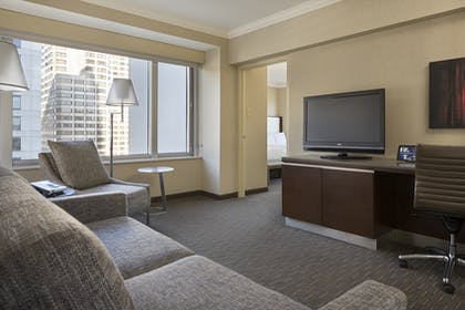 Living Area | Corner 1 Bedroom Suite with 2 Beds - Tower 1 | Hilton San Francisco Union Square