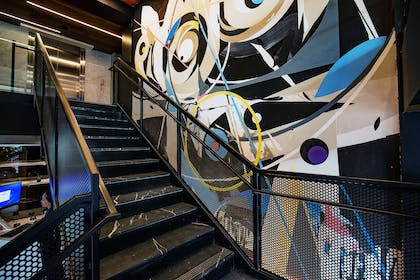 Lobby Staircase Victor Reyes Piece | YOTEL San Francisco