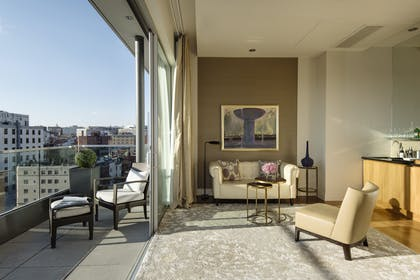 Living room with balcony | Luxury Suite with Balcony + Luxury Suite without Balcony | The Dupont Circle Hotel